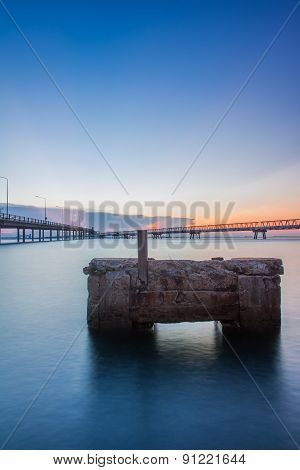 Concrete Bridge Over Sea Water With Sunrise
