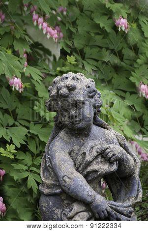 Statue In Bleeding Hearts
