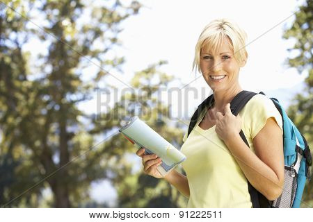 Middle Aged Woman Hiking Through Countryside