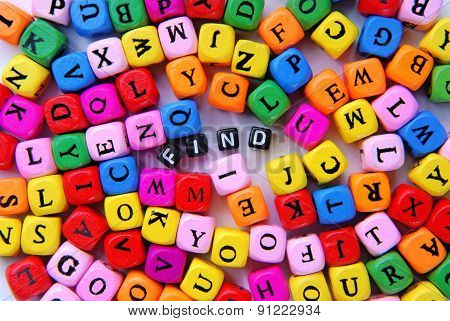 muticolor mixed letters and black word find