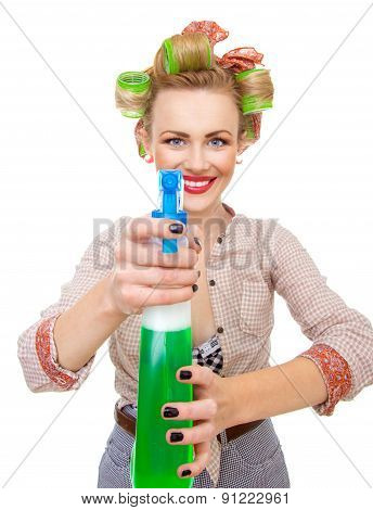 Funny Smiling Housewife / Woman Spraying The Cleaner On You, Isolated On White. Glass Or Window Clea