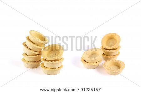Pile of empty tartlets isolated