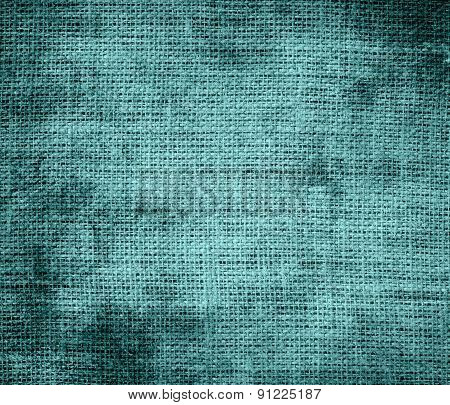 Grunge background of cadet blue burlap texture