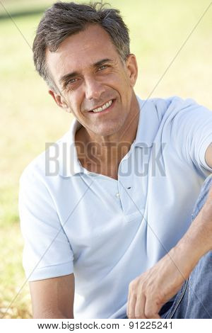 Middle Aged Man Relaxing In Countryside
