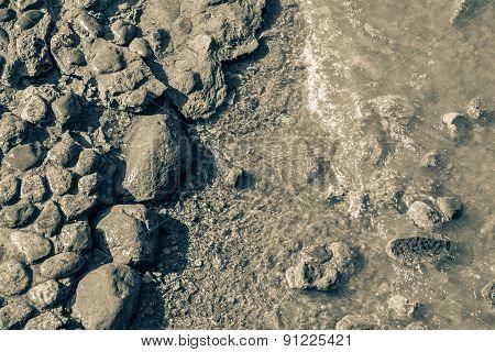 Dirty Stones On The Coast
