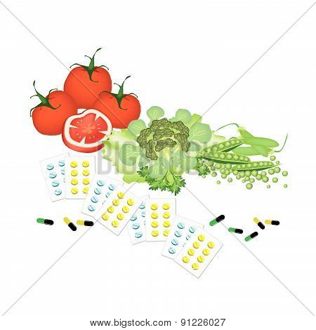 Vegetables And Vitamine Capsules On White Background.