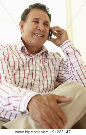 Senior Hispanic Man Using Cellphone