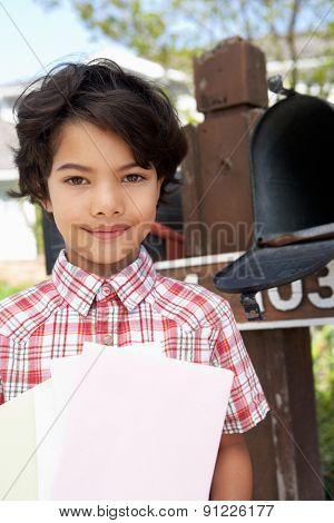 Hispanic Boy Checking Mailbox