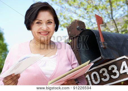 Senior Hispanic Woman Checking Mailbox