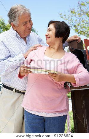 Senior Hispanic Couple Checking Mailbox