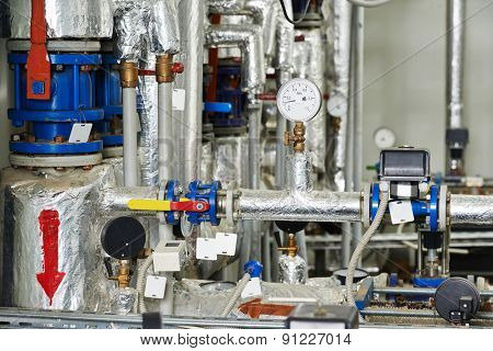 manometers, pipes and faucet valves of gas heating or water circulation system in a boiler room