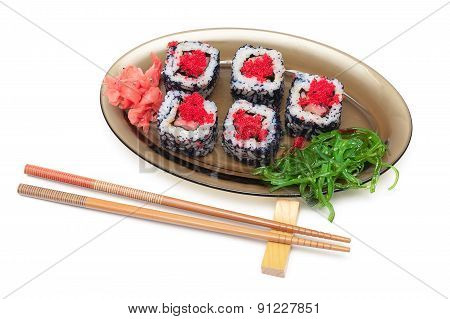 Rolls With Caviar, Chuka Salad On A Plate And Chopsticks On A White Background