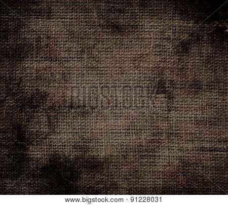 Grunge background of cafe noir burlap texture