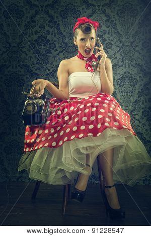 Vintage style - Woman talking with dial phone in polka dots clothes
