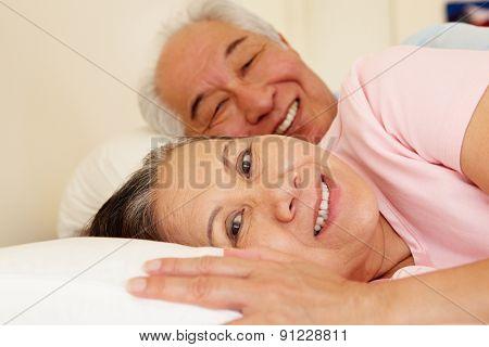 Senior Taiwanese couple resting