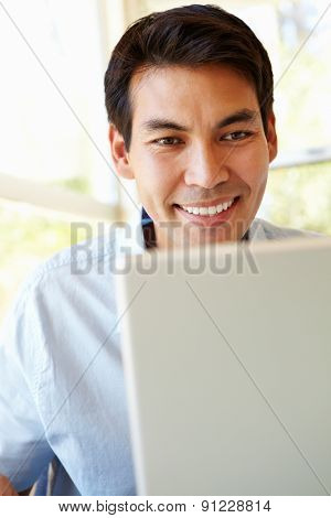 Filipino man working on laptop