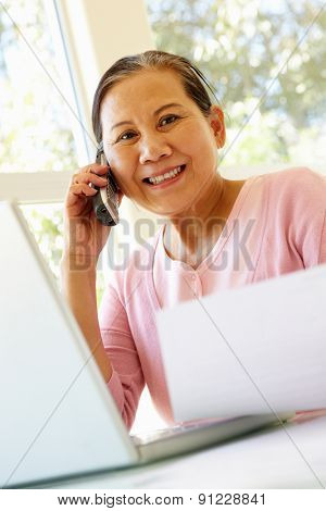 Senior Taiwanese woman working at home