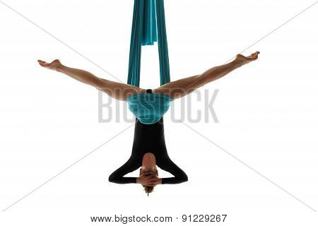 Aerial Performer Hanging On Silk In Symmetric Pose