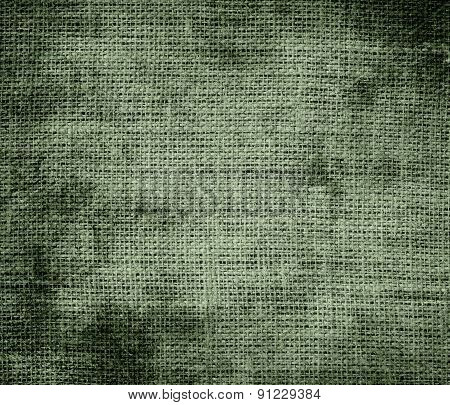 Grunge background of camouflage green burlap texture
