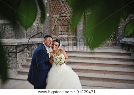 Newlywed Embrace Near Of Stairs Old Church