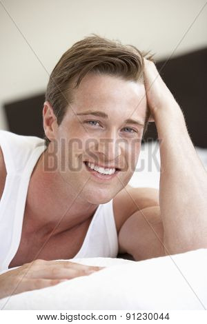Young Man Relaxing On Bed