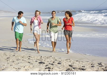 Young Friends Running Along Beach