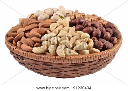 Assorted Nuts In A Wicker Bowl On A White Background