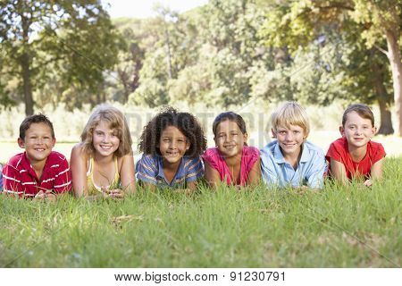 Group Of Children Relaxing In Countryside