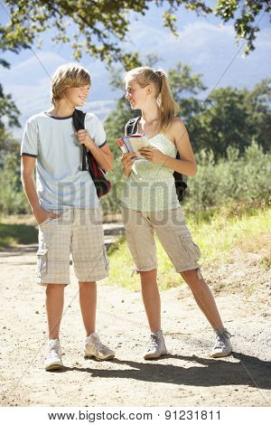 Teenage Couple Hiking Through Countryside