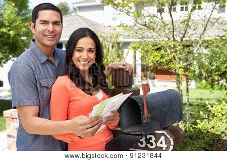 Hispanic Couple Checking Mailbox