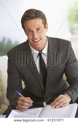 Portrait Of Businessman Working On Documents
