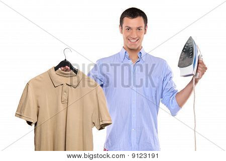 Man Holding A Blue And White Clothing Iron And His T-shirt