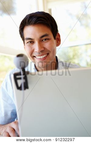 Filipino man using skype