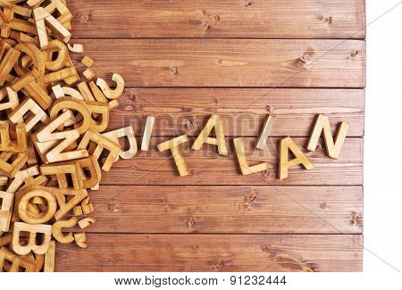 Word italian made with wooden letters