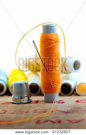 Nedle With Orange Color Thread