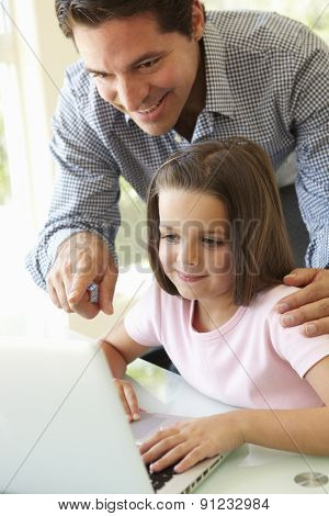 Hispanic Father And Daughter Using Laptop
