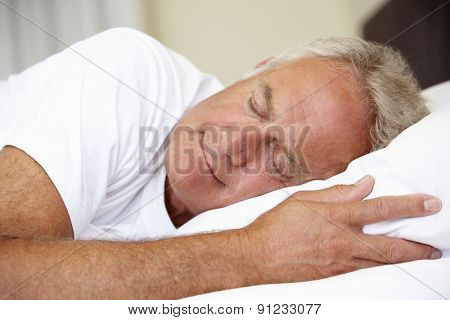 Senior Man Asleep In Bed