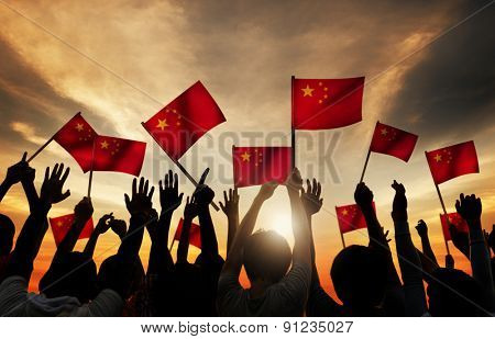 Silhouettes of People Holding the Flag of China Concept