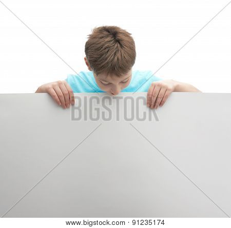 Young boy with a sheet of paper