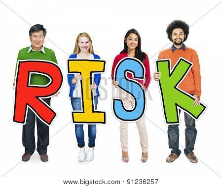 Group of People Standing Holding Risk Letter Concept