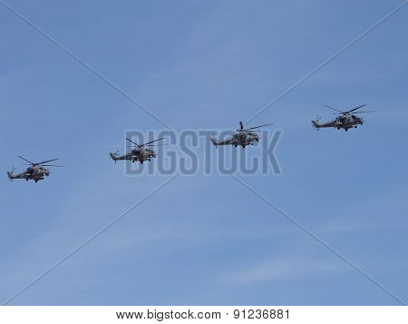Four Mi-35 Flying Formation On The Blue Sky