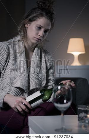 Woman Holding Bottle Of Wine