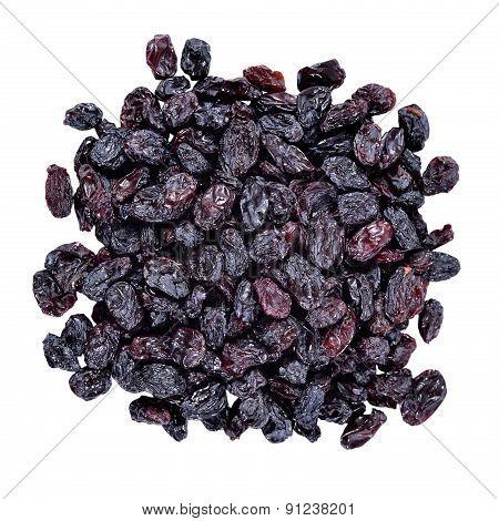 Heap Of Dark Raisins On A White