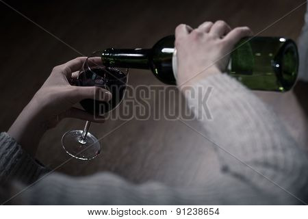 Alcoholic's Hands Pouring Wine