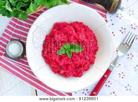 Beetroot risotto with parmesan cheese