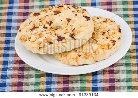 Two Shortbreads Rings With Peanuts In Plate On Tablecloth
