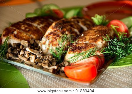 Breading Chicken Cutlets On A Plate With Dill Cucumbers, Tomatoes And Mushrooms