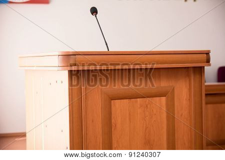Podium With Microphone In The Hall For Speaker