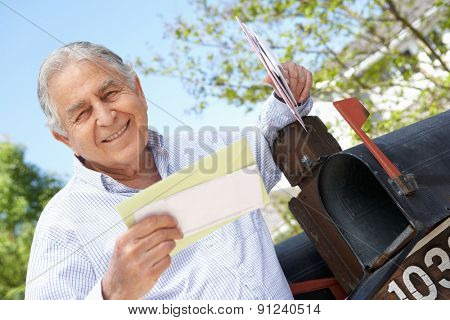 Senior Hispanic Man Checking Mailbox
