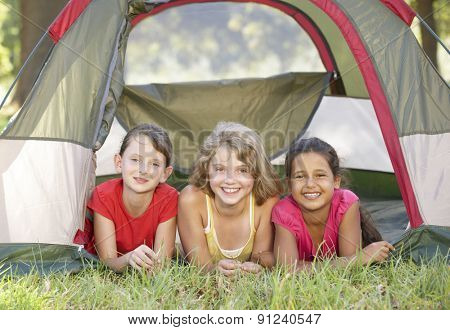 Group Of Girls Having Fun In Tent In Countryside
